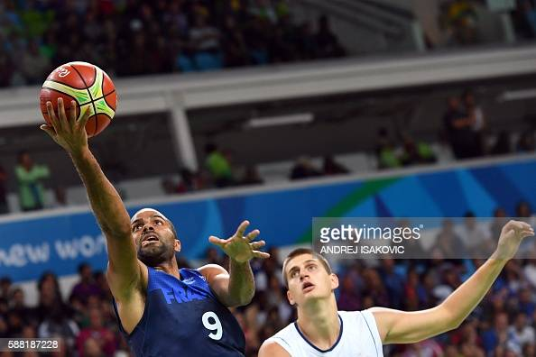 TOPSHOT France's point guard Tony Parker goes to the basket next to Serbia's power forward Nikola Jokic during a Men's round Group A basketball match...