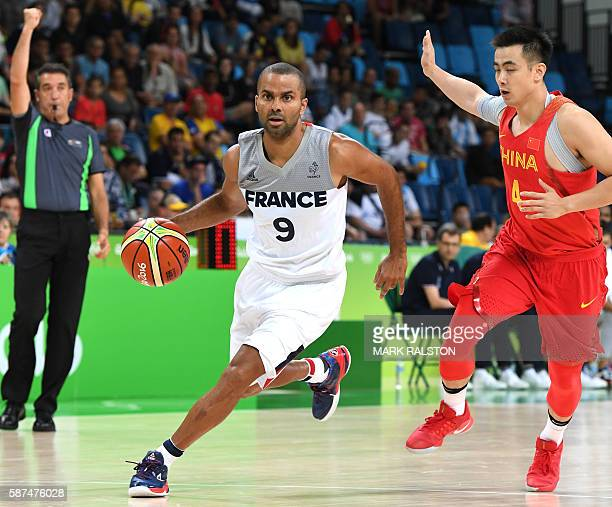 TOPSHOT France's point guard Tony Parker runs during a Men's round Group A basketball match between France and China at the Carioca Arena 1 in Rio de...