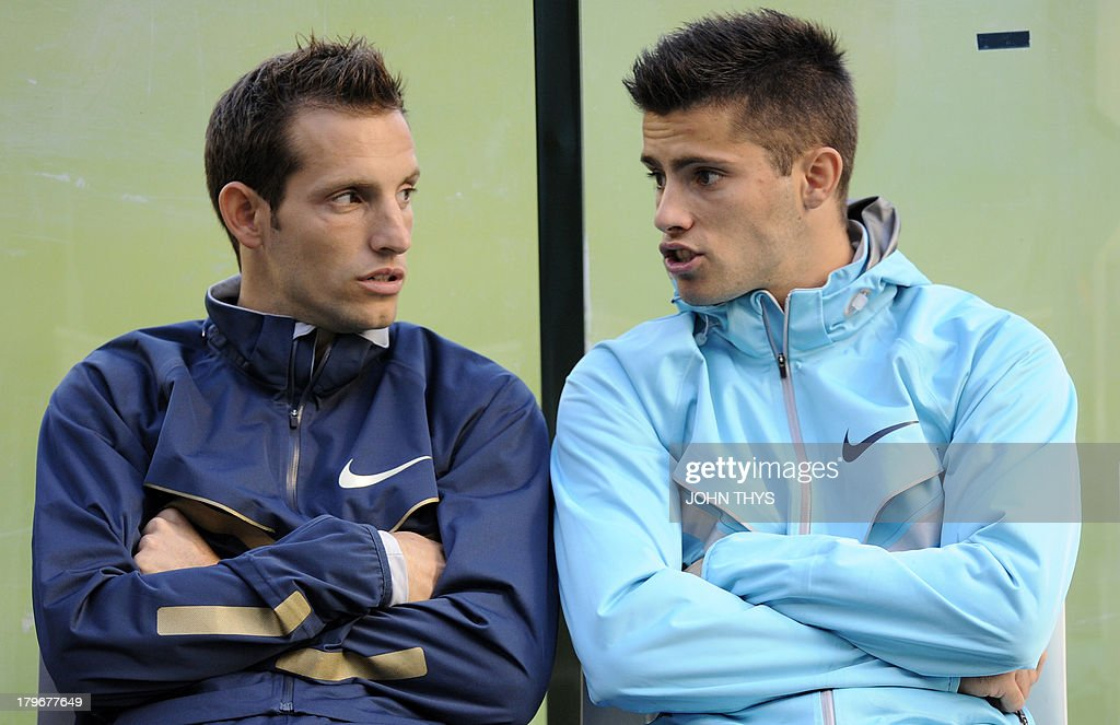 France's pole vaulter Renaud Lavillenie (L) speaks with his brother Valentin Lavillenie during the Diamond League athletics meeting in Brussels on September 6, 2013.