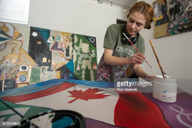 Frances Potts works on a painting that will be on display A project which brings youth and art together in celebration of Canada's 150th anniversary...
