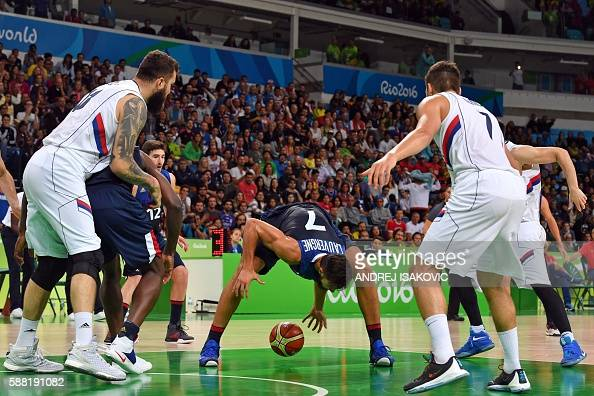TOPSHOT France's power forward Joffrey Lauvergne fails to catch the ball during a Men's round Group A basketball match between Serbia and France at...