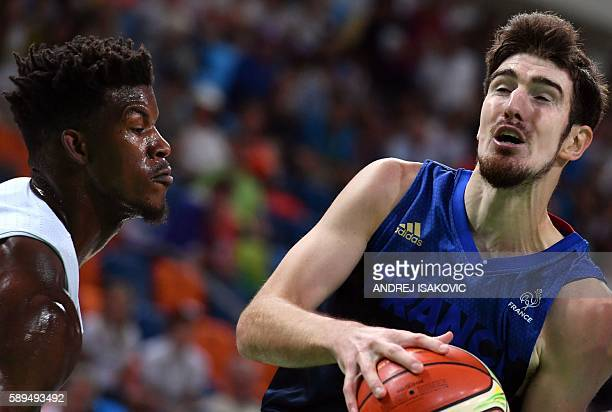 France's power forward Joffrey Lauvergne works around USA's forward Jimmy Butler during a Men's round Group A basketball match between USA and France...