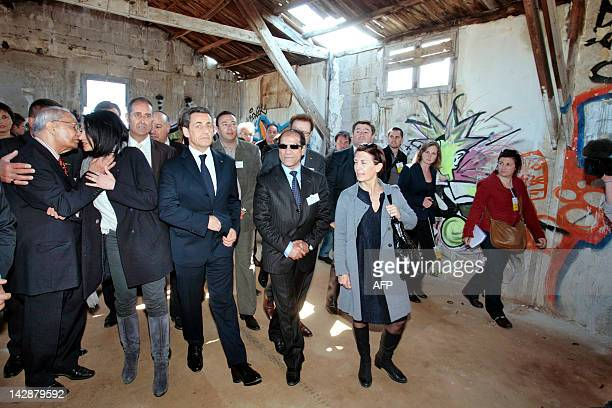 France's President and UMP party candidate for his reelection Nicolas Sarkozy arrives with Youth and Associations Junior Minister Jeannette Bougrab...