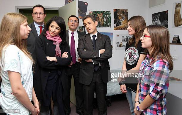 France's President and UMP party candidate for the 2012 French presidential elections Nicolas Sarkozy flanked by France's Youth and Associations...
