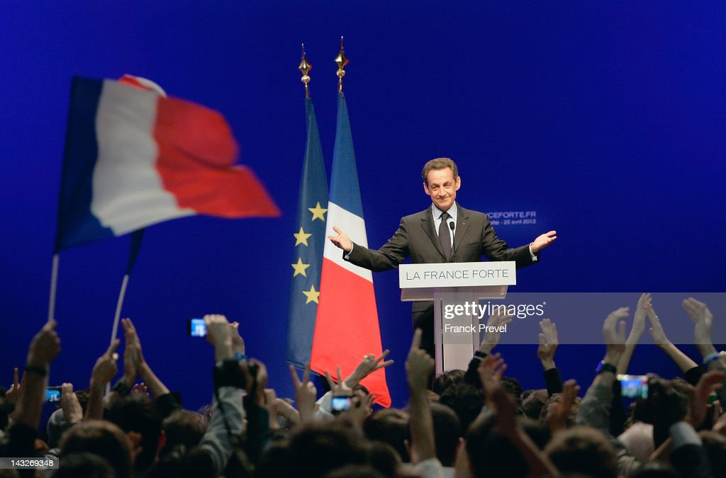 France's President and Union for a Popular Movement candidate for the 2012 presidential election Nicolas Sarkozy delivers a speech following the...