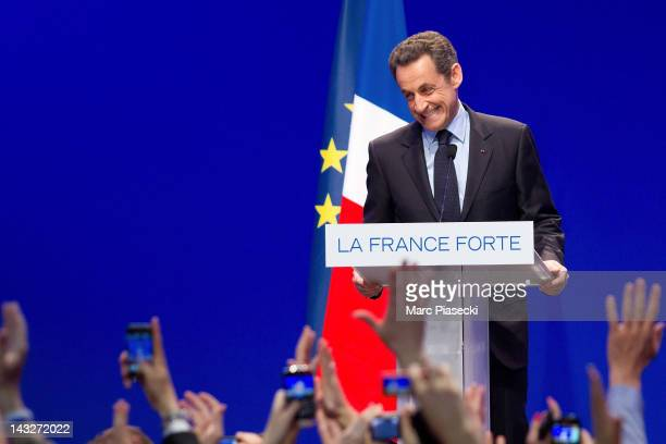 France's President and Union for a Popular Movement candidate for the 2012 presidential election Nicolas Sarkozy delivers a speech after the first...