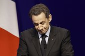 France's President and Union for a Popular Movement candidate for the 2012 presidential election Nicolas Sarkozy acknowledges the audience on April...