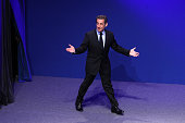 France's President and Union for a Popular Movement candidate for the 2012 presidential election Nicolas Sarkozy arrives on stage on April 22 2012...