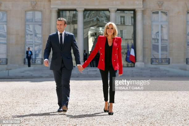 France's President Emmanuel Macron and his wife Brigitte Macron arrive for the launching of a program to enhance the diagnosis and treatment of...