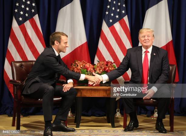 France's president Emmanuel Macron and US President Donald Trump shake hands before a meeting at the Palace Hotel during the 72nd session of the...