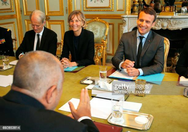 France's President Emmanuel Macron flanked by French Minister of European Affairs Marielle de Sarnez listens to Bulgaria's new Prime Minister Boiko...