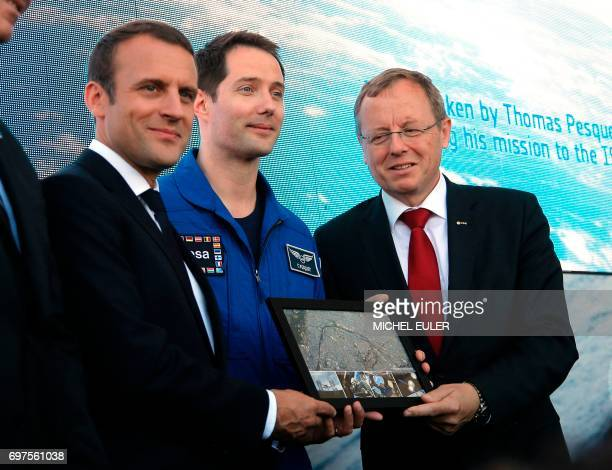 France's President Emmanuel Macron French astronaut Thomas Pesquet and European Space Agency Director General JohannDietrich Woerner pose on June 19...