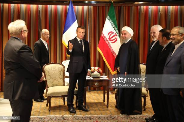 France's President Emmanuel Macron gestures as he poses for a picture with his Iranian counterpart Hassan Rouhani along with Iran's foreign minister...