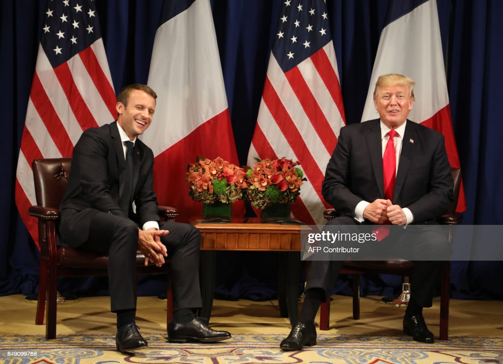 France's president Emmanuel Macron (L) laughs with US President Donald Trump before a meeting at the Palace Hotel during the 72nd session of the United Nations General Assembly on September 18, 2017, in New York. / AFP PHOTO / ludovic MARIN