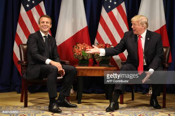 TOPSHOT France's president Emmanuel Macron laughs with US President Donald Trump before a meeting at the Palace Hotel during the 72nd session of the...