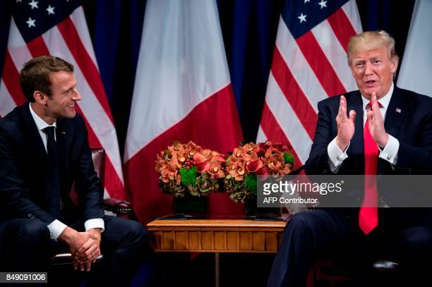 France's President Emmanuel Macron listens while US President Donald Trump speaks about the Bastille Day Parade before a meeting at the Palace Hotel...