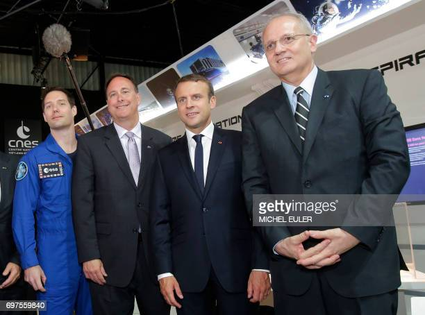 France's President Emmanuel Macron NASA administrator Robert M Lightfoot Jr President of the National Space Studies Centre JeanYves Le Gall and...
