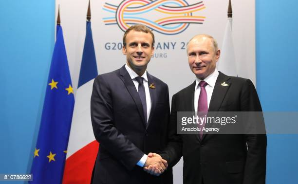 France's President Emmanuel Macron shakes hands with Russia's President Vladimir Putin after their meeting during G20 Leaders' Summit in Hamburg...