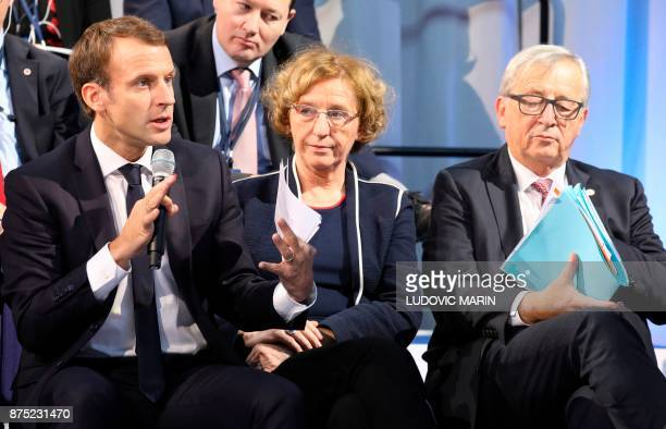 France's President Emmanuel Macron speaks next to French Labour Minister Muriel Penicaud as European Commission President JeanClaude Juncker listens...