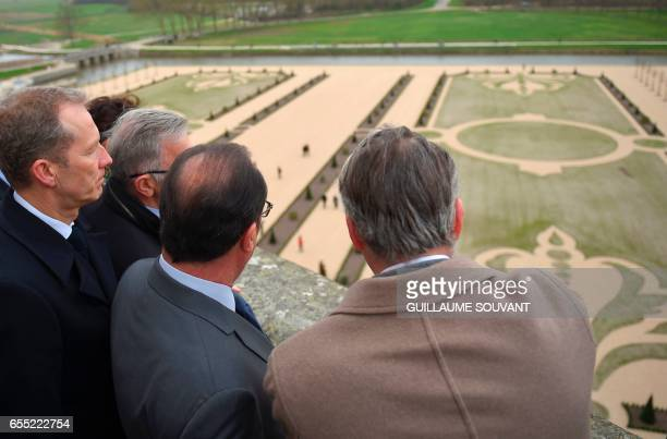 France's President Francois Hollande accompanied by director general of the Domaine National de Chambord Jean d'Haussonville looks out from the...
