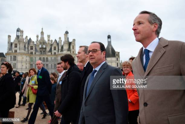 France's President Francois Hollande accompanied by director general of the Domaine National de Chambord Jean d'Haussonville visits the Domaine...