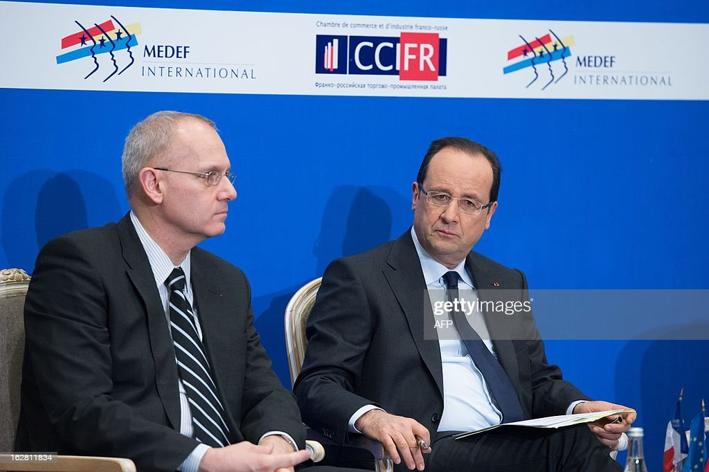 France's President Francois Hollande (R) and Arianespace Chairman and CEO, Jean-Yves Le Gall, attend a meeting with Russian and French businessmen at an economic forum in Moscow on February 28, 2013, prior to a meeting with Russia's President Vladimir Putin at the Kremlin.