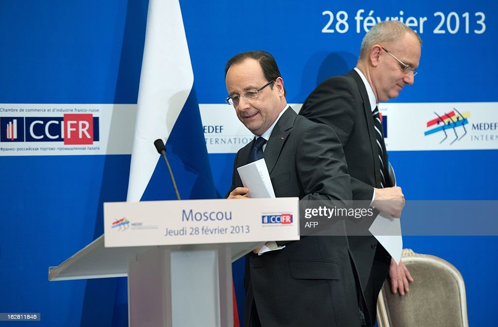France's President Francois Hollande (L) and Arianespace Chairman and CEO, Jean-Yves Le Gall, attend a meeting with Russian and French businessmen at an economic forum in Moscow on February 28, 2013, prior to a meeting with Russia's President Vladimir Putin at the Kremlin.