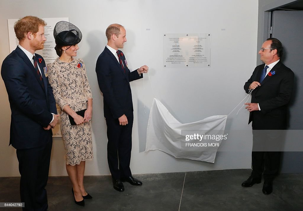 France's President Francois Hollande (R) and Britain's Prince William (2R) unveil a commemorative plate inside the World War I Thiepval monument northern France, on July 1, 2016 as Britain's Catherine, Duchess of Cambridge (2R) and Prince Harry (2) look, during the Somme battle's centenary commemorations. One week after Britain's vote to leave the European Union, Prime Minister David Cameron and royal family members will stand side-by-side with France's President to celebrate their historic alliance at the centenary of the deadliest battle of World War I. / AFP / POOL / Francois Mori