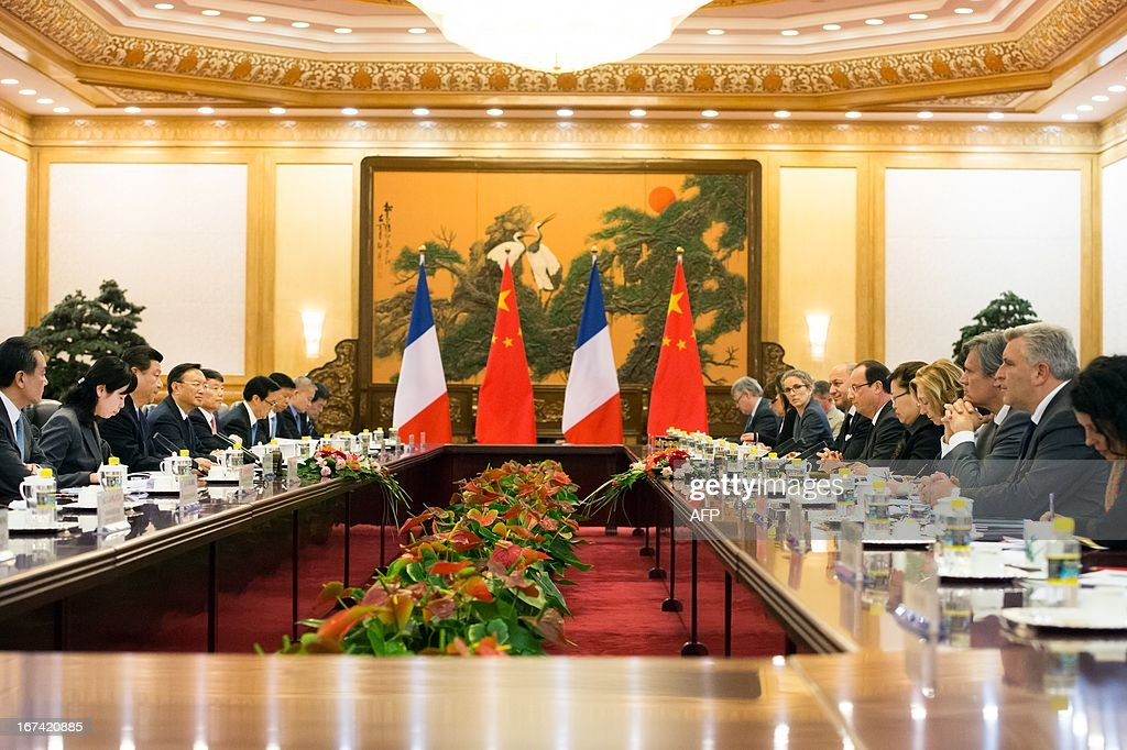 France's President Francois Hollande (6th R) and his Chinese counterpart Xi Jinping (3rd L) take part in a meeting with ministers as part of a two-day visit of State at the Great Hall of the People in Beijing on April 25, 2013.