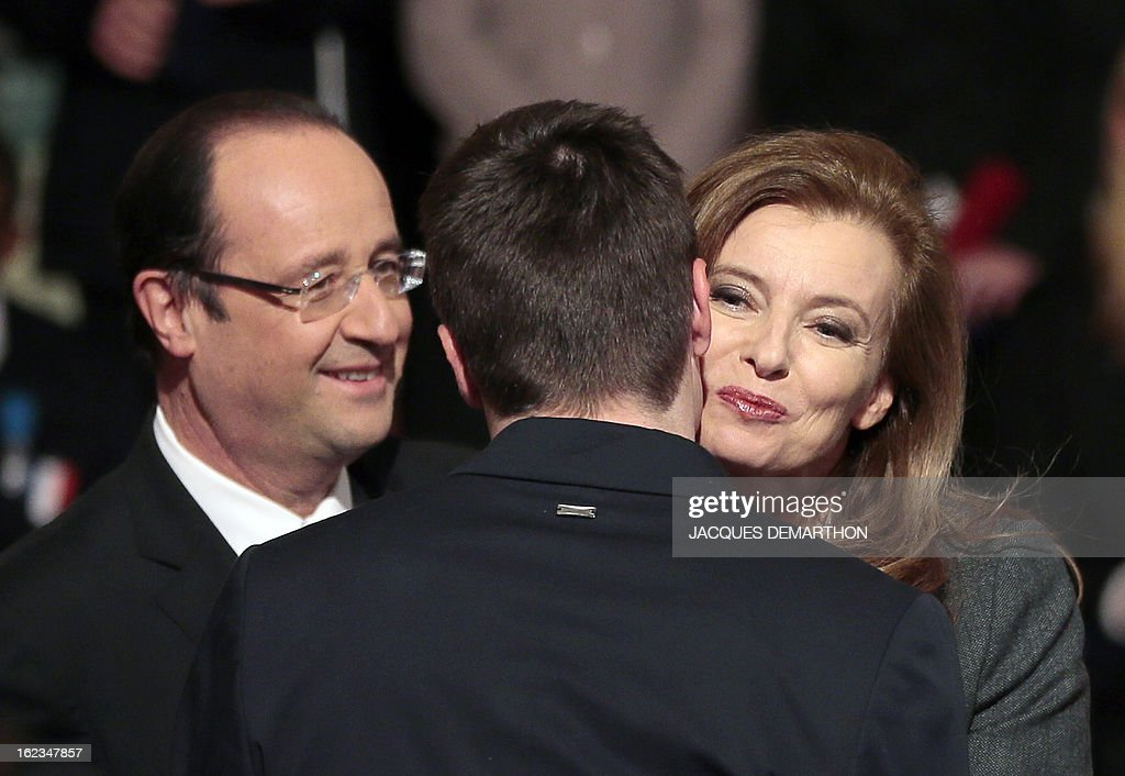 France's President Francois Hollande (L) and his companion Valerie Trierweiler congratulate a French athlete, medalist of the 2012 London Paralympic Games, during a ceremony at the Elysee presidential Palace on February 22, 2013 in Paris.