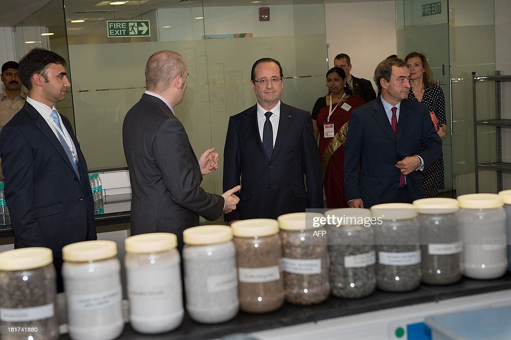 France's President Francois Hollande (C) and his companion Valerie Trierweiler (R) visit a Lafarge construction development lab in Mumbai on February 15, 2013 during a two-day state visit to India. French President Francois Hollande wrapped up his two-day trip to India on Friday with a call for more investment and trade between the countries as he met with business leaders.