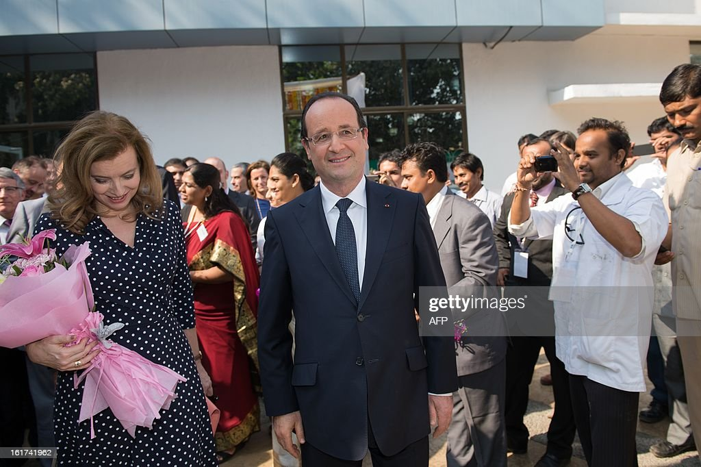 France's President Francois Hollande (C) and his companion Valerie Trierweiler (L) visit a Lafarge construction development lab in Mumbai on February 15, 2013 during a two-day state visit to India. French President Francois Hollande wrapped up his two-day trip to India on Friday with a call for more investment and trade between the countries as he met with business leaders.