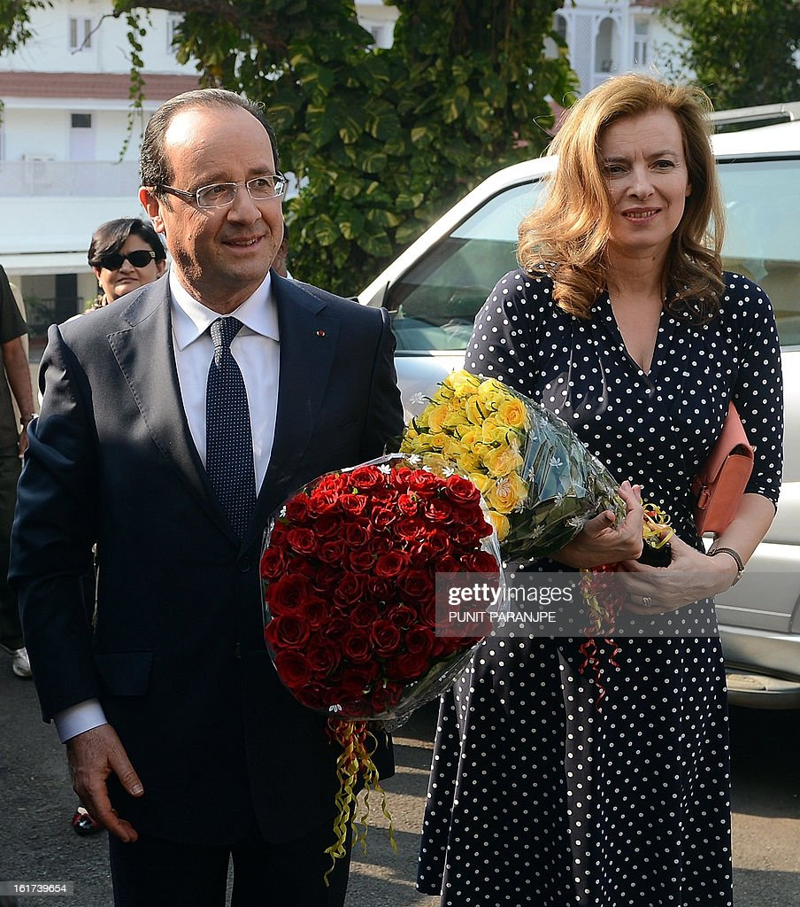 France's President Francois Hollande (L) and his partner Valerie Trierweiler pose for photographers at the residence of the Governor of the western Indian state of Maharashtra in Mumbai on February 15, 2013. French President Francois Hollande wrapped up his two-day trip to India on Friday with a call for more investment and trade between the countries as he met with business leaders.