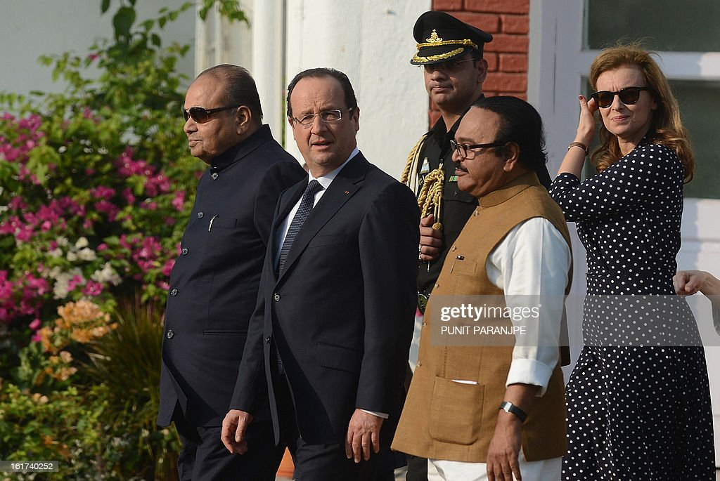 France's President Francois Hollande (2L) and his partner Valerie Trierweiler (R) walk with Governor of Maharashtra state K. Sankaranarayanan (L) and minister Chagan Bhujbal at the residence of the Governor in Mumbai on February 15, 2013. French President Francois Hollande wrapped up his two-day trip to India on Friday with a call for more investment and trade between the countries as he met with business leaders.