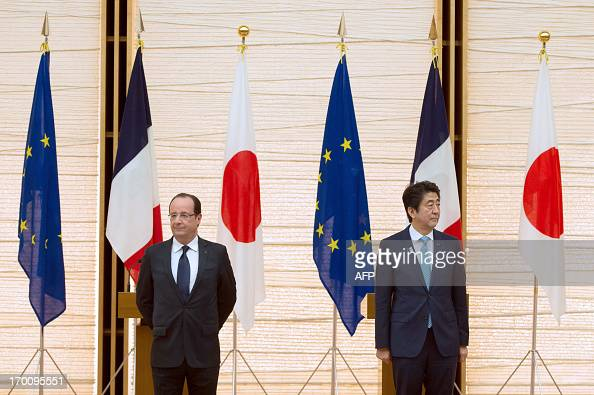 France's President Francois Hollande and Japanese Prime Minister Shinzo Abe attend a press conference following their meeting at the prime ministers...