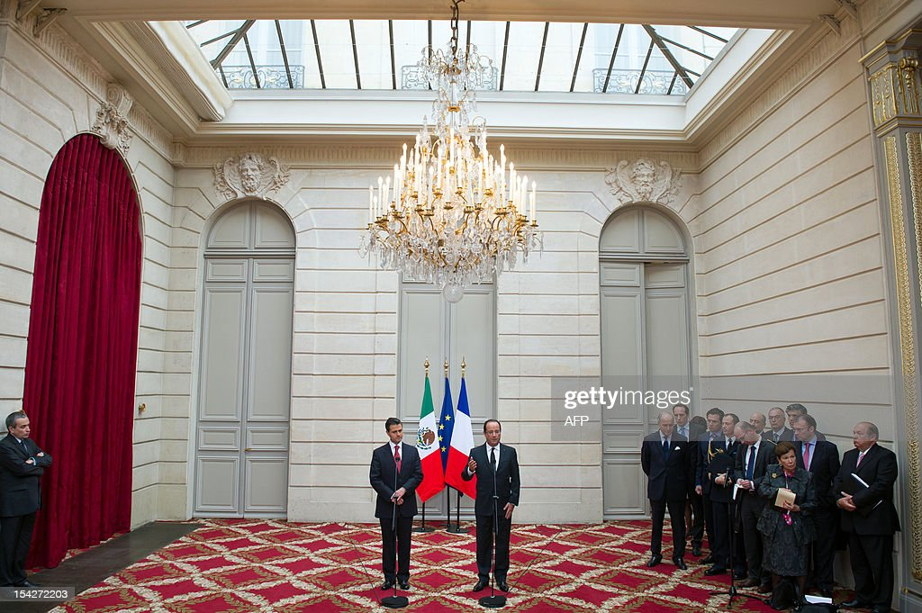 France's President Francois Hollande (R) and Mexican President-elect Enrique Pena Nieto take part in a press conference at the Elysee presidential palace on October 17, 2012 in Paris. Pena Nieto will start his six-year term as president on December 1, marking the return of the Institutional Revolutionary Party (PRI) to the nation's highest office after a 12-year absence.