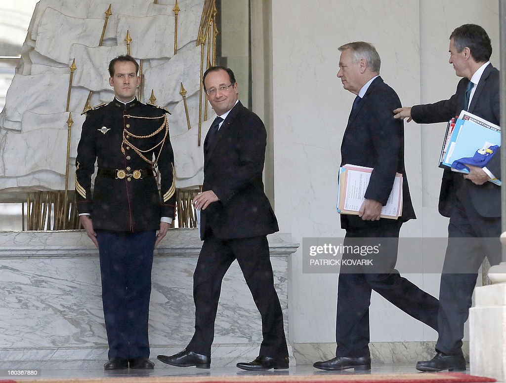 France's President, Francois Hollande (2ndL) and Prime Minister, Jean-Marc Ayrault (2ndR) flanked by French Junior Minister for Budget, Jerome Cahuzac (R), are pictured at the Elysee presidential Palace after the weekly cabinet meeting on January 30, 2013 in Paris. AFP PHOTO / PATRICK KOVARIK