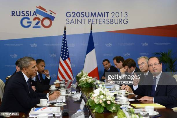 Frances President Francois Hollande and US President Barack Obama speak during a bilateral meeting at the G20 summit on September 6 2013 in Saint...
