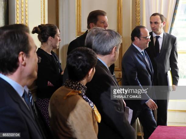 France's President Francois Hollande arrives at the signing ceremony of a protocol to welcome refugees coming from Lebanese camps at the Elysee...