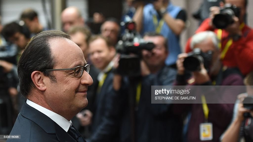 France's President Francois Hollande arrives before an EU summit meeting on June 29, 2016 at the European Union headquarters in Brussels. European Union leaders will assess the damage from Britain's decision to leave the bloc and try to prevent further disintegration, as they meet for the first time without a British representative on June 29, 2016. And as the shockwaves reverberate around British politics, Scottish First Minister Nicola Sturgeon is also expected in Brussels 'utterly determined' to keep her pro-EU country in the club despite the Brexit vote. SAKUTIN