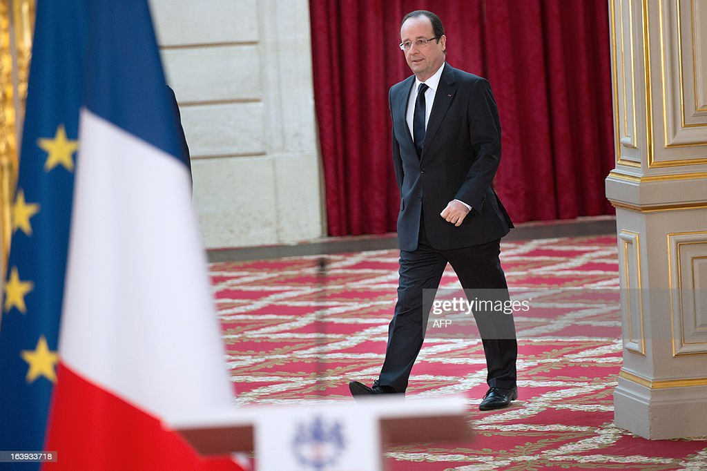 France's President Francois Hollande arrives for a speech after European aerospace giant Airbus and Lion Air comapny have signed a contract on March 18, 2013 during a ceremony at the Elysee presidential palace in Paris. Airbus announced a record order worth 18.4 billion euros ($ 23.8 billion) from Indonesia's Lion Air for 234 medium-haul A320 jets. Lion Air, Indonesia's largest private carrier and one of the world's fastest growing airlines, is a new client for Airbus as it has previously been equipped almost exclusively by US rival Boeing.
