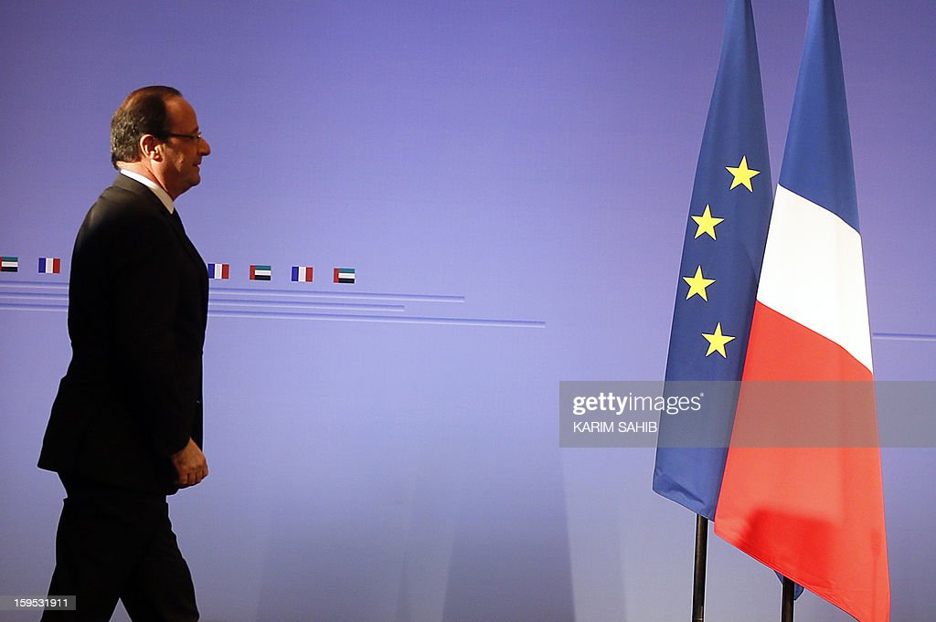 France's President Francois Hollande arrives to a press conference at the World Future Energy Summit (WFES) in Dubai on January 15, 2013.