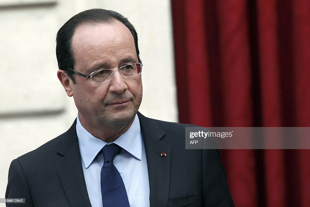 France's President Francois Hollande arrives to deliver a speech during a ceremony in honour of French troops that served in Afghanistan, on December 21, 2012 at the Elysee Palace, in Paris. Hollande has declared 'mission accomplished' for French combat troops who returned home recently from Afghanistan. France still has 1,500 troops in Afghanistan repatriating equipment or working in roles like providing medical care or helping run Kabul's airport. Hollande said the numbers will decline to 500 by mid-2013. AFP PHOTO POOL THIBAULT CAMUS