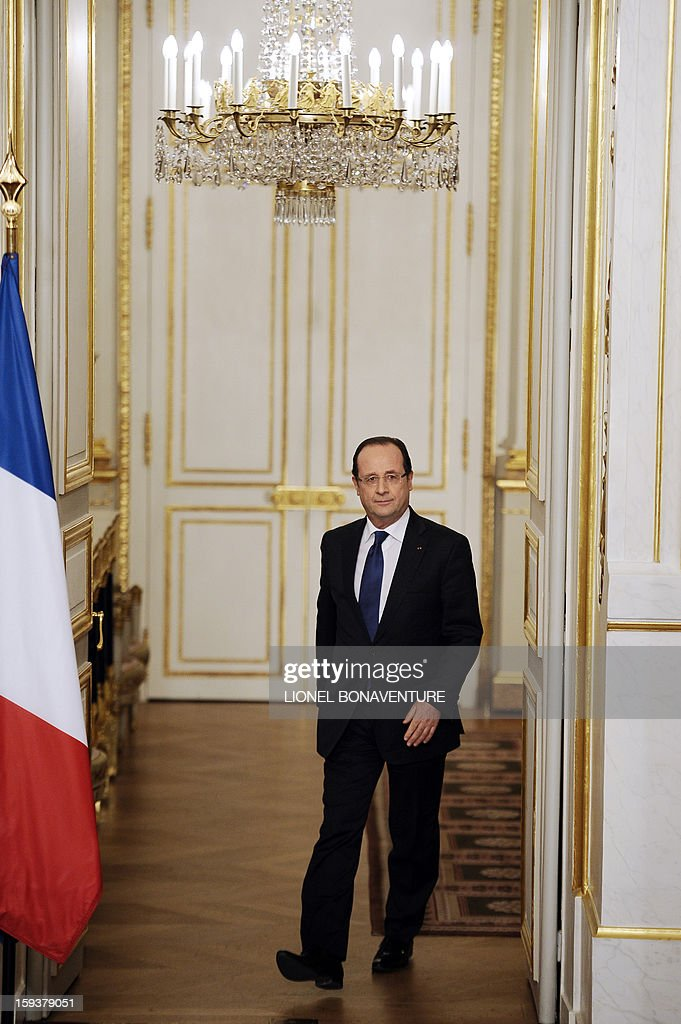 France's president Francois Hollande arrives to give a speech focused on the Malian situation, on January 12, 2013 at the Elysee presidential palace in Paris. Backed by French air power, Malian troops on January 11, 2013 unleashed an offensive against Islamist rebels who, having seized control of the north of the country in March last year, were threatening to push south. France has asked the United Nations to 'accelerate' implementation of a resolution that enables the deployment of an international force to Mali. AFP PHOTO / POOL / LIONEL BONAVENTURE