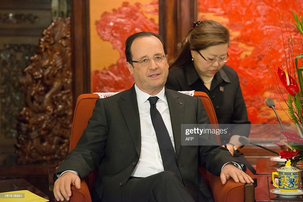 France's President Francois Hollande attends a meeting with Chinese Premier Li Keqiang (not pictured) at the Zhongnanhai leadership compound in Beijing on April 26, 2013. Hollande arrived in Beijing on April 25 for a two-day China trip aimed at boosting exports to China, with hopes that deals can be reached over the sale of aircraft and nuclear power.