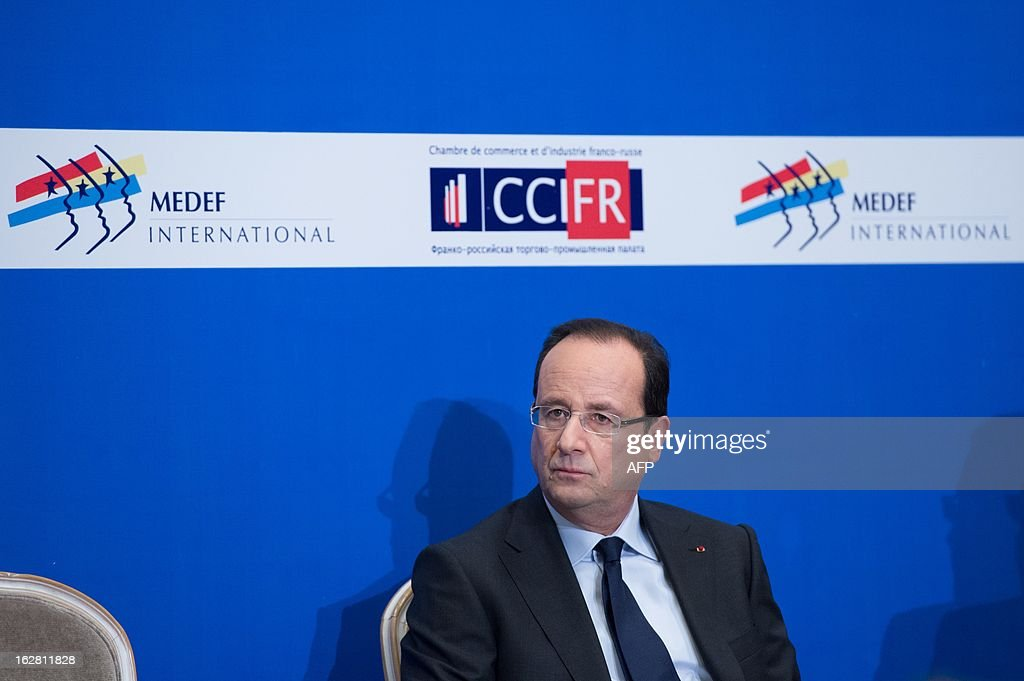 France's President Francois Hollande attends a meeting with Russian and French businessmen an economic forum in Moscow on February 28, 2013, prior to attend a meeting with Russia's President Vladimir Putin at the Kremlin.