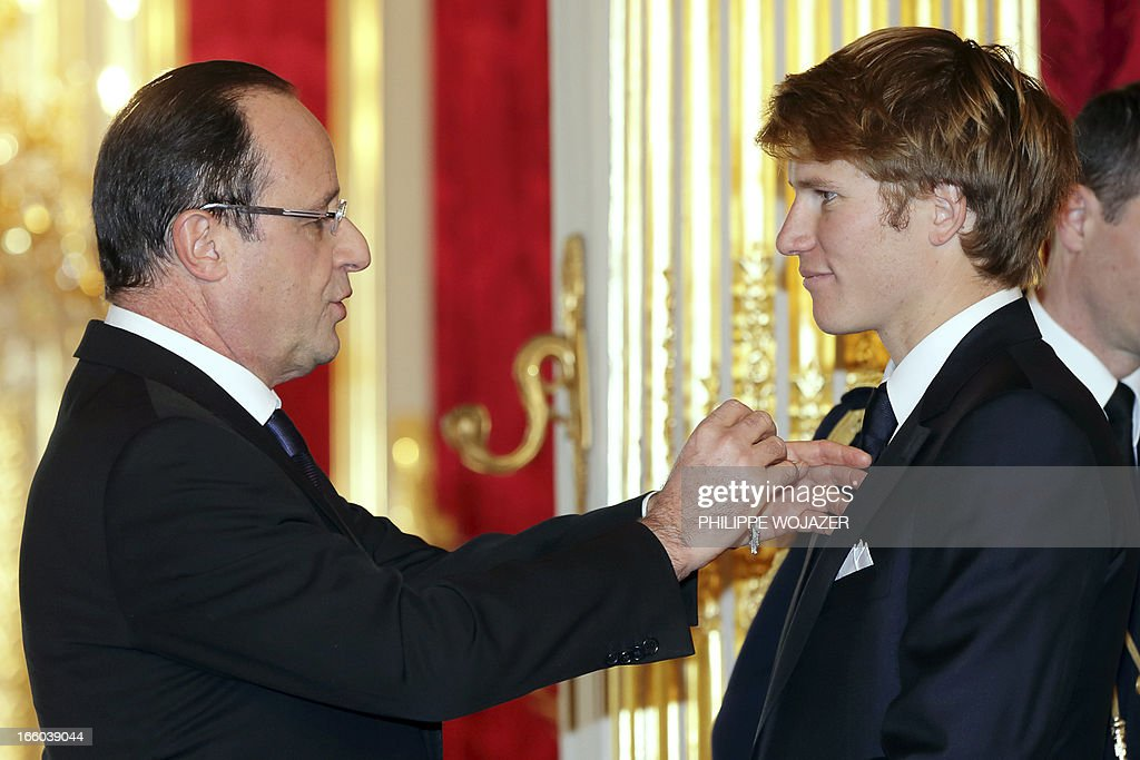 France's President Francois Hollande (L) awards French skipper Francois Gabart with the French Legion of Honor, the highest decoration in France, for his January victory in the Vendee Globe solo round-the-world yacht race, at the Elysee Palace in Paris, on April 8, 2013.