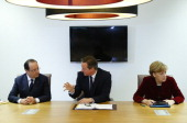 France's President Francois Hollande Britain's Prime Minister David Cameron and Germany's Chancellor Angela Merkel speak during a meeting to discuss...