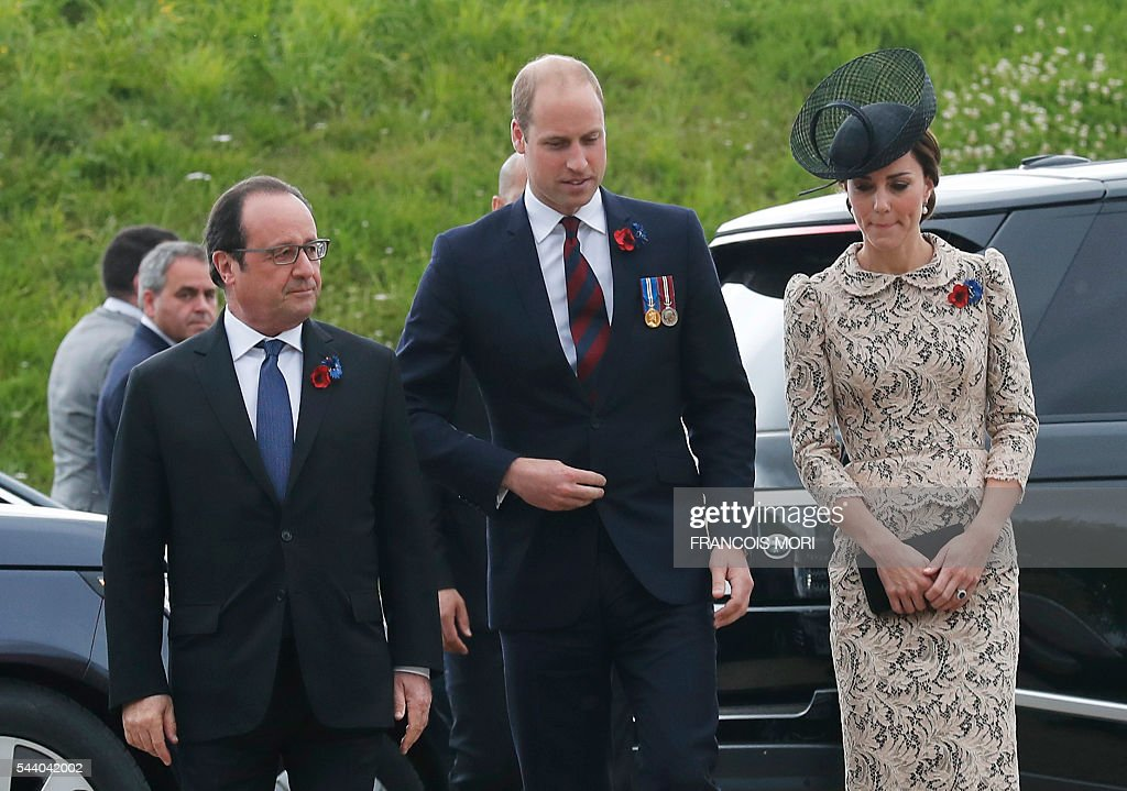 France's President Francois Hollande (L), Britain's Prince William (C) and his wife Britain's Catherine, Duchess of Cambridge walk as they arrive in Thiepval, northern France, on July 1, 2016 to attend the Somme battle's centenary commemorations. One week after Britain's vote to leave the European Union, Prime Minister David Cameron and royal family members will stand side-by-side with France's President to celebrate their historic alliance at the centenary of the deadliest battle of World War I. / AFP / POOL / Francois Mori