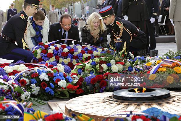 France's President Francois Hollande Caroline and Charles childrens of French servicemens killed in action lay down a wreath at the Arc de Triomphe...
